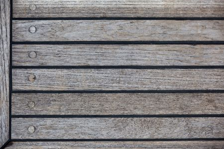 sealant: A background texture image of teak decking with black sealant.