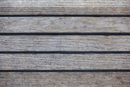 A background texture image of teak decking with black sealant. photo