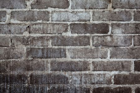 A background texture image of stained brick wall. photo