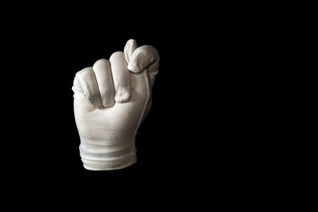 A white gloved hand isolated on black background. American sign language alphabet T. Stock Photo - 5864299