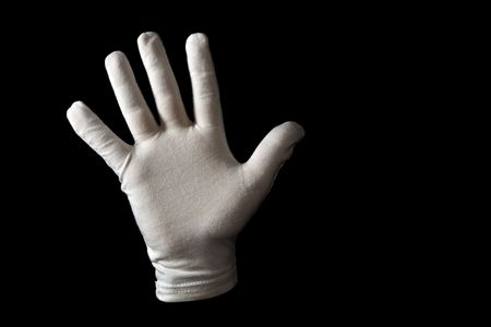 gloved: A white gloved hand isolated on black background. Sign language number five. Stock Photo