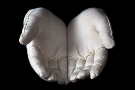 gloved: A white gloved hand isolated on black background. Offering palms of hands.