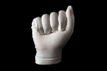 A white gloved hand isolated on black background. Clenched fist. photo