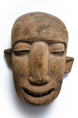 A wooden african face mask with asymmetric ears, shot on white background. photo