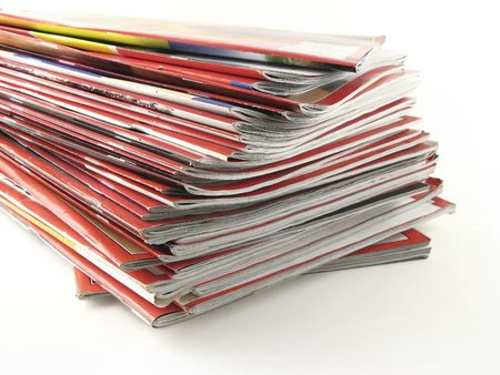 A stack of red magazines against white background. Banco de Imagens
