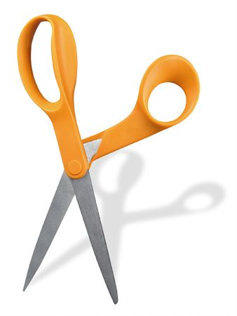 Upright pair of scissors with orange handles against white background.