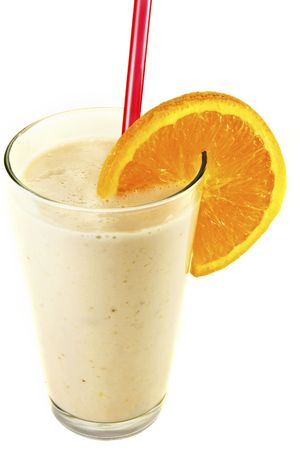 Smoothie beverage with orange slice against a white background