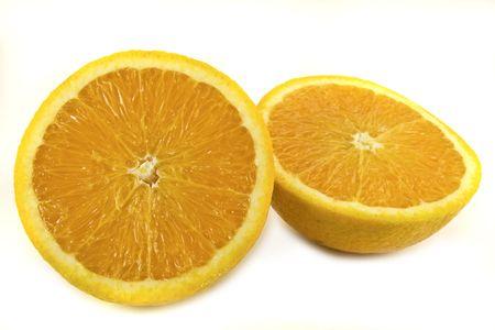 Fresh orange sliced in half against a white background.