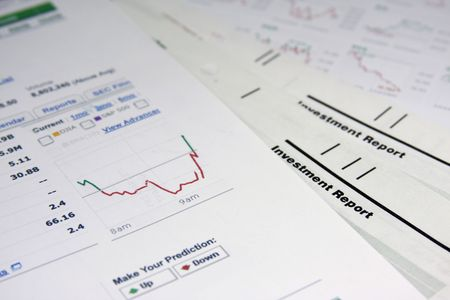 Close up of stock market graphs and documents.