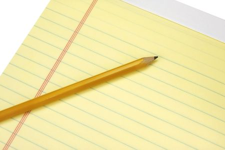 legal pad: Yellow legal pad with a single pencil on a blank page.