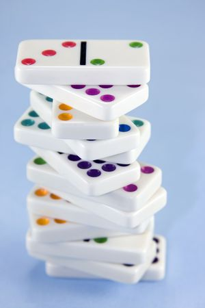 Stack of dominoes against a blue background. photo