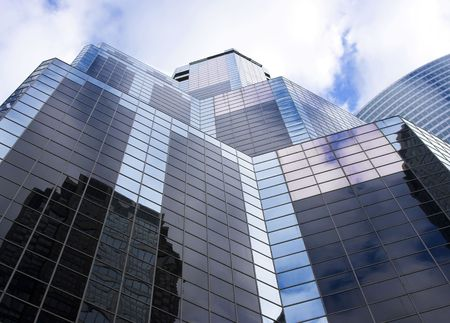 Chicago office building against a blue sky with white clouds. Stock Photo