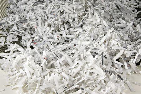 Shredded paper in black mesh waste basket
