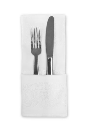 Flatware wrapped with a white linen napkin against a white background