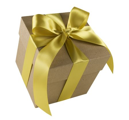 Gift box tied with gold bow and ribbon against a white background. Stock Photo
