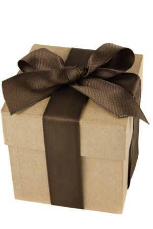 Gift bow tied with brown bow and ribbon against a white background. Stok Fotoğraf