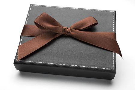 Black gift box with brown ribbon and bow.