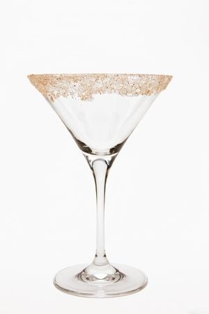 Empty martini glass with rim of glass garnished with salt, sugar and pepper mixture.