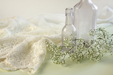 negligee: Lacy negligee with two vintage apothecary bottles and baby breath flowers.