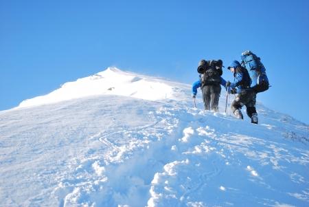 mountain climber: Hike in a winter mountain