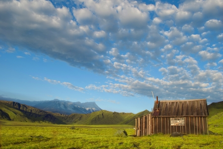 beautiful landscape of blue sky, mountain and rustic lodge photo