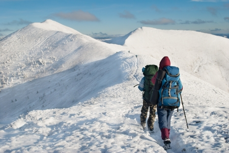 hikers in the snowy mountains Standard-Bild