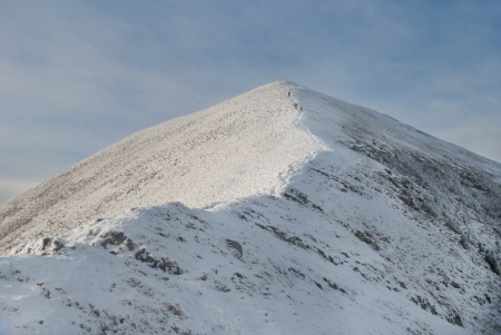 landscape of snowy mountain with footpaith on peak photo