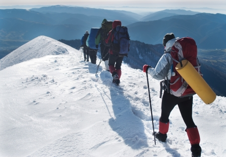 hikers in the snowy mountains