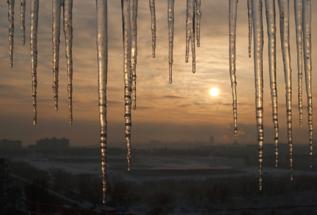 icicke on roof with beautiful sunrise in the city Stock Photo - 17032951