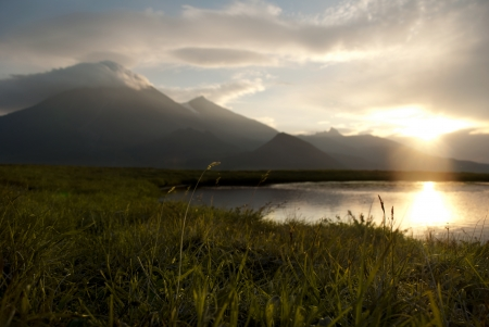 calm evening landscape with lake and mountains, Russia, Kamchatka Standard-Bild