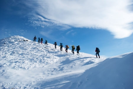ice climbing: hikers in a winter mountain Stock Photo