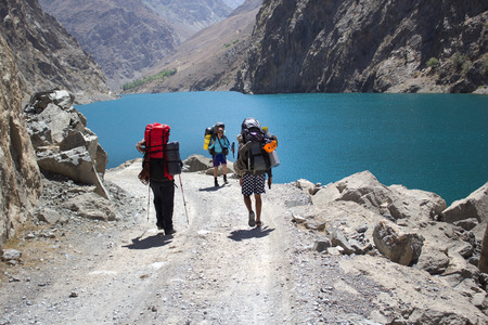 group of backpackers hiking in high mountains of central Asia, Tajikistan