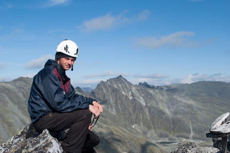 young male hiker sitting on rest, Ural mountains, Russia