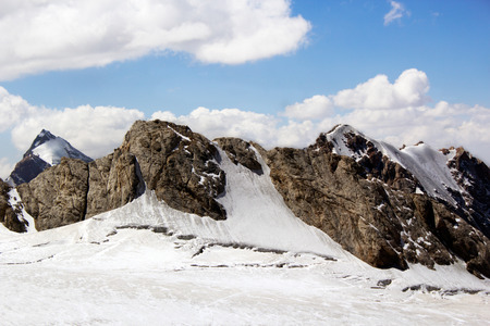 sunny landscape of snow-covered ridge, blue sky and clouds, central Asia, Tajikistan Standard-Bild