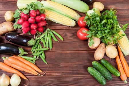 frame of vegetables on wooden background