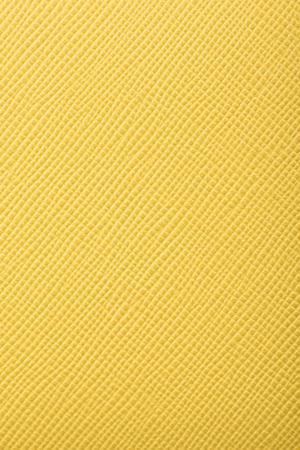 cracklier: yellow color embossed leather texture background vertical