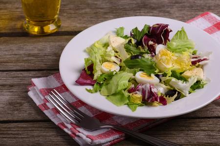 salad greens: Green vegetarian fresh salad mix, still life on rustic wooden background