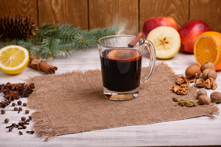 Mulled wine punch and spices for glintwine on wooden background Standard-Bild