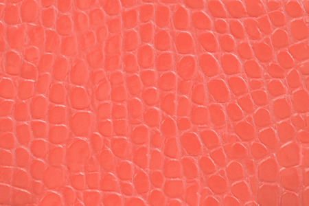 cracklier: red color embossed leather background texture vertical