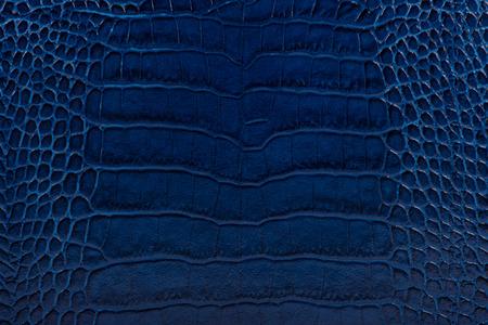 cracklier: dark blue color embossed leather background texture