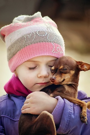 Beautiful girl holding embrace small brown chihuahua dog, friendship concept