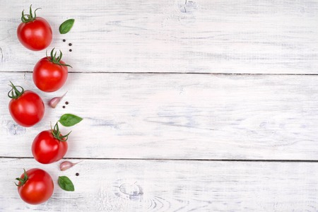 tomato: tomatoes on a white wooden table, pasta ingredients top view copy space