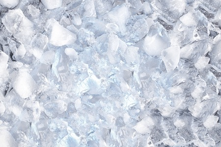 glace pil�e: background with crushed ice cubes, top view