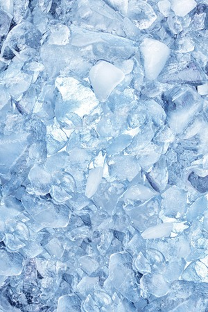 ice cold: background with crushed ice cubes, top view