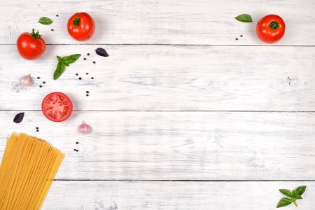 Italian pasta ingredients on white wooden table, top view, copy space