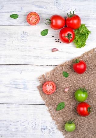 fresh vegetable: tomatoes on a white wooden table, pasta ingredients top view copy space