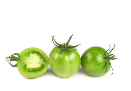 Fresh green tomatoes isolated on white background, closeup