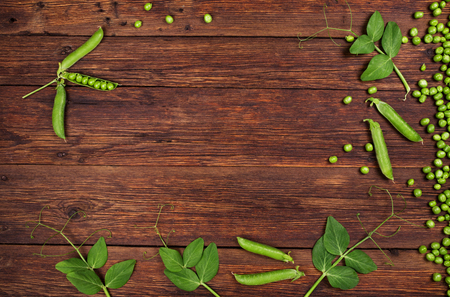 green pea: fresh green peas on old wooden table top view Stock Photo