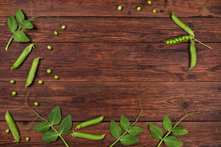 pea: fresh green peas on old wooden table top view Stock Photo