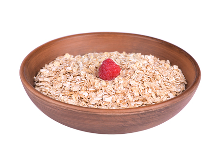 oatmeal bowl: Oatmeal bowl with raspberry isolated on white